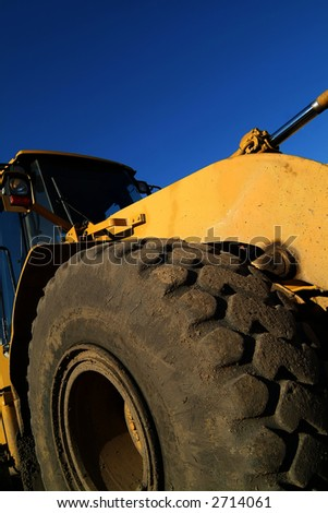 detail of building  bulldozer against blue sky - stock photo