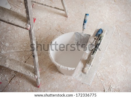 Detail of building site painting equipment in the house - stock photo