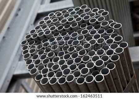 Detail of bundle of steel pipes - stock photo