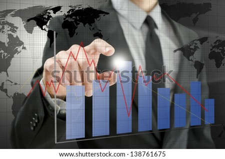 Detail of business man pointing at interactive business graph.