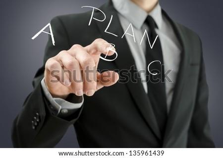 Detail of businessman hand choosing plan B on a virtual screen. - stock photo