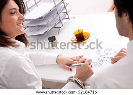 Detail of businesspeople hands working on a firewall schema (selective focus) - stock photo