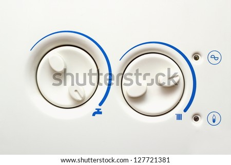 detail of buttons of an old household heating appliance