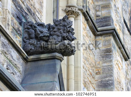 Detail of Canadian Parliament building in Ottawa. Above the entrance the limestone sculpture of Wolves. - stock photo