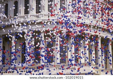 Detail of Capitol Building with red, white, and blue balloons - stock photo