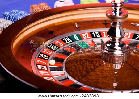 Detail of casino roulette with blue roulette table - stock photo