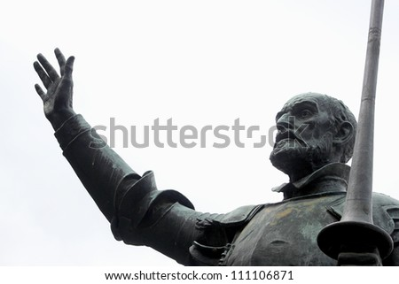 Detail of Cervantes monument represent Don Quijote, caracter of spanish novelist Cervantes, isolated on white background - stock photo