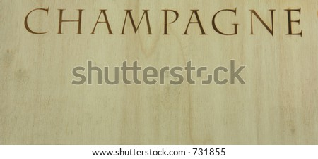 Detail of champagne box: 'champagne' printed on wooden surface