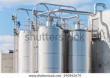 Detail of chemical plant, silos and pipes - stock photo