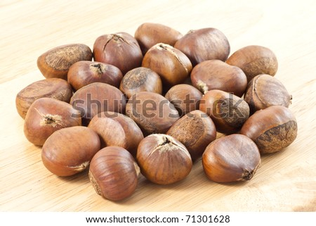 Detail of Chestnut on wood board - stock photo