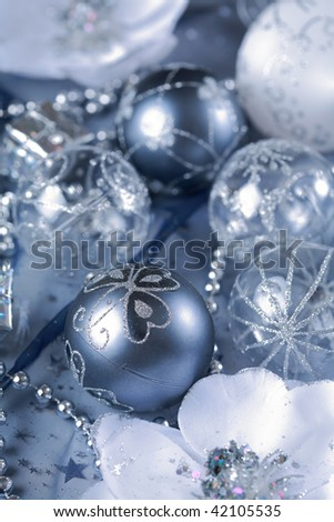 Detail of Christmas balls with flowers in silver tone