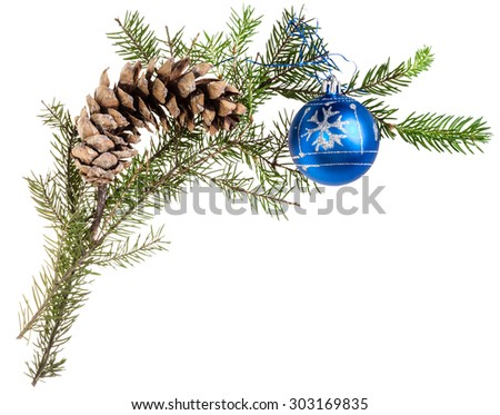 detail of christmas frame - twig of spruce tree with cone and blue ball on white background - stock photo