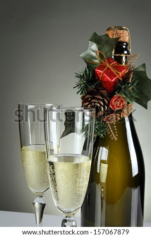 Detail of Christmas glasses and a bottle of champagne . Holiday and New years eve - stock photo