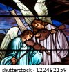 Detail of Christmas stained glass window depicting two angels playing musical instruments - stock photo