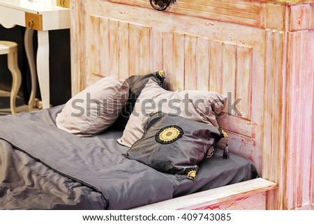Detail of classic furniture bed with pillows in bedroom. - stock photo