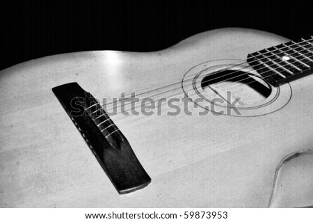 Detail of classic guitar. Old instrument background theme with retro film texture - stock photo