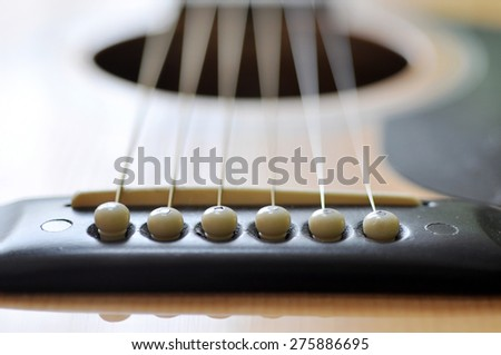 Detail of classic guitar strings with shallow depth of field - stock photo