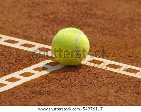 Detail of clay court with tennis ball on the line - stock photo