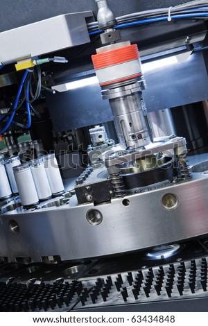 detail of cnc punching machine - stock photo