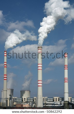 detail of coal power plant with chimney and cooling towers - stock photo