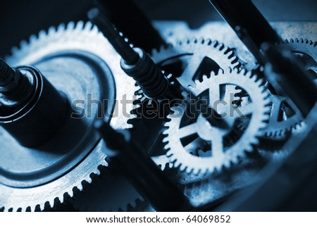detail of cogwheels in old clock - stock photo