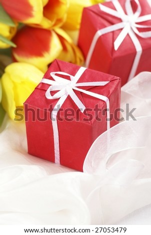 Detail of colorful tulips and red gifts