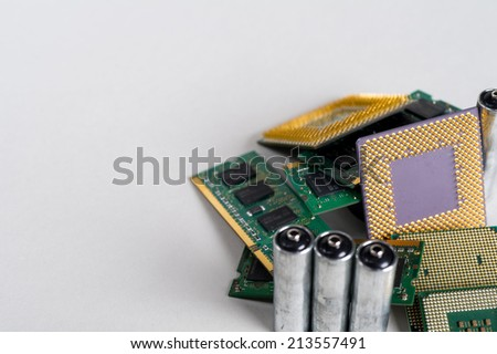Detail of computer components and batteries designated to be recycled. Recycling concept Shot with focus on computer processor. Great for background - stock photo