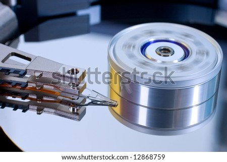 Detail of computer hard disk head and spinning platters