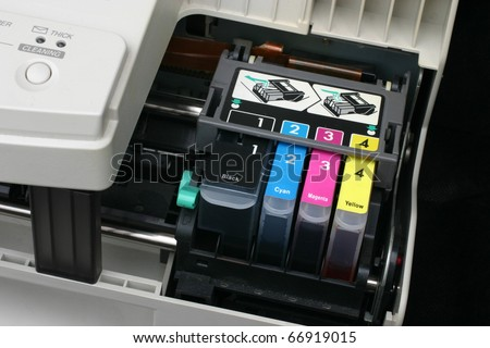 Detail of computer printer ink cartridges with separate units in carrier.