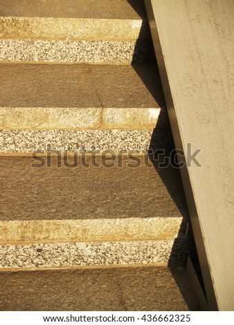 Detail of concrete stairway with metallic ramp sunlit - stock photo