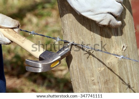 detail of construction of new steel fence in farm on countryside in brazil - stock photo