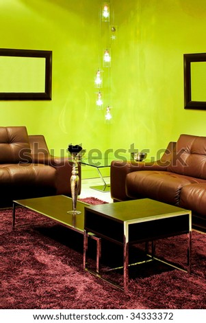 Detail of contemporary living room with green walls - stock photo