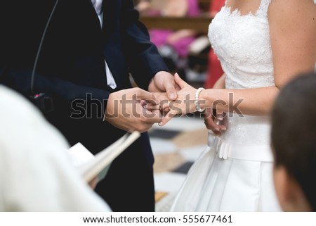 Detail of couple's hands getting married. Close-up view.