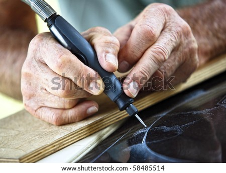 detail of craftman during make incision on marble - stock photo