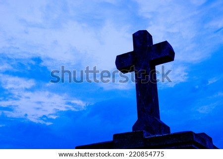 detail of cross on the blue sky - stock photo