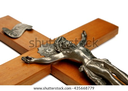 Detail of crucifix on white background, statue of jesus close up - stock photo