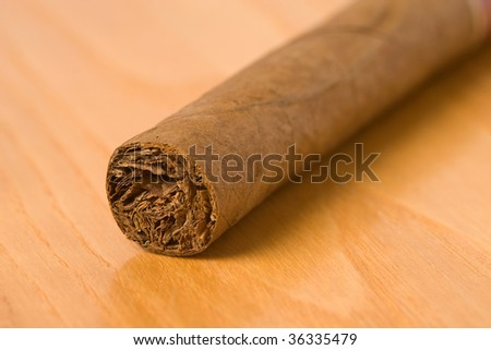 detail of cuban cigar on table