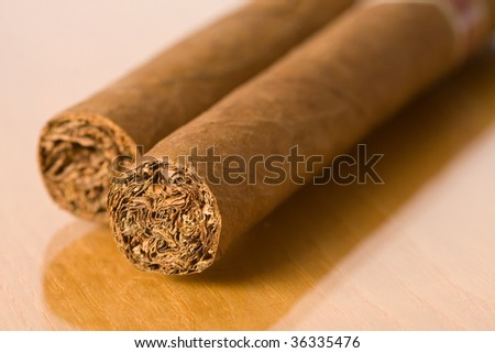 detail of cuban cigars on table