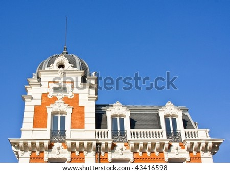 Detail of cupola of a building with the blue sky to the background - stock photo