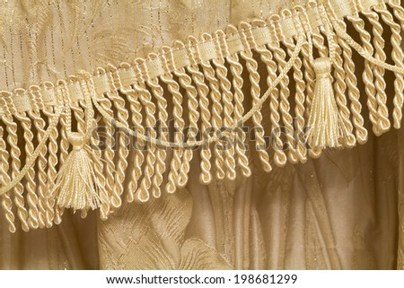 Detail of curtains with fringe and tassels, background - stock photo