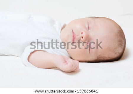 detail of cute month old baby sleeping - stock photo