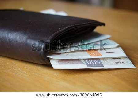 Detail of Czech currency (Czech Crowns, CZK, K?) in the leather wallet