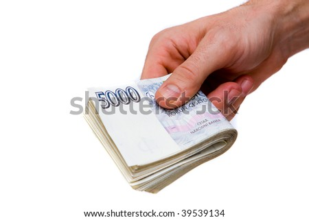 Detail of czech money - the czech currency and man hand - stock photo