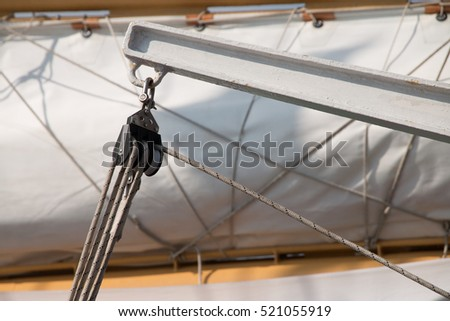 Detail of Deck, pulley block and ropes, rigging on a tall ship, sail yacht. Close up view sail yacht