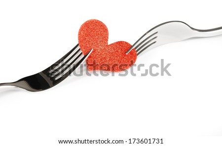 detail of decorative red heart near forks on white background with space for text, concept valentine day dinner  - stock photo