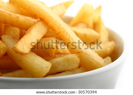 Detail of deep fried french fries in ceramic bowl isolated on white - stock photo