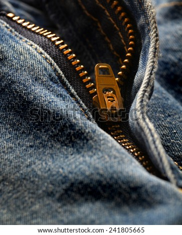 Detail of denim zipper on old worn jeans - stock photo