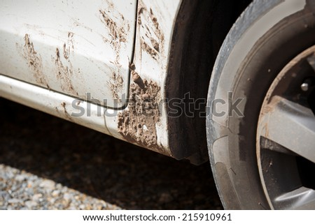 Detail of dirty car with filled mud - carwash concept - stock photo