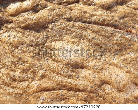 Detail of dirty water stems from the pipe polluting the river - stock photo