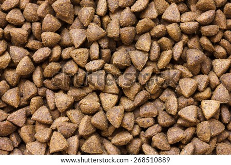Detail of dry brown pet food. From above. - stock photo